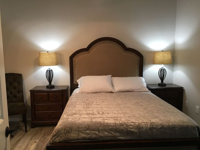 Large master bedroom with private balcony access