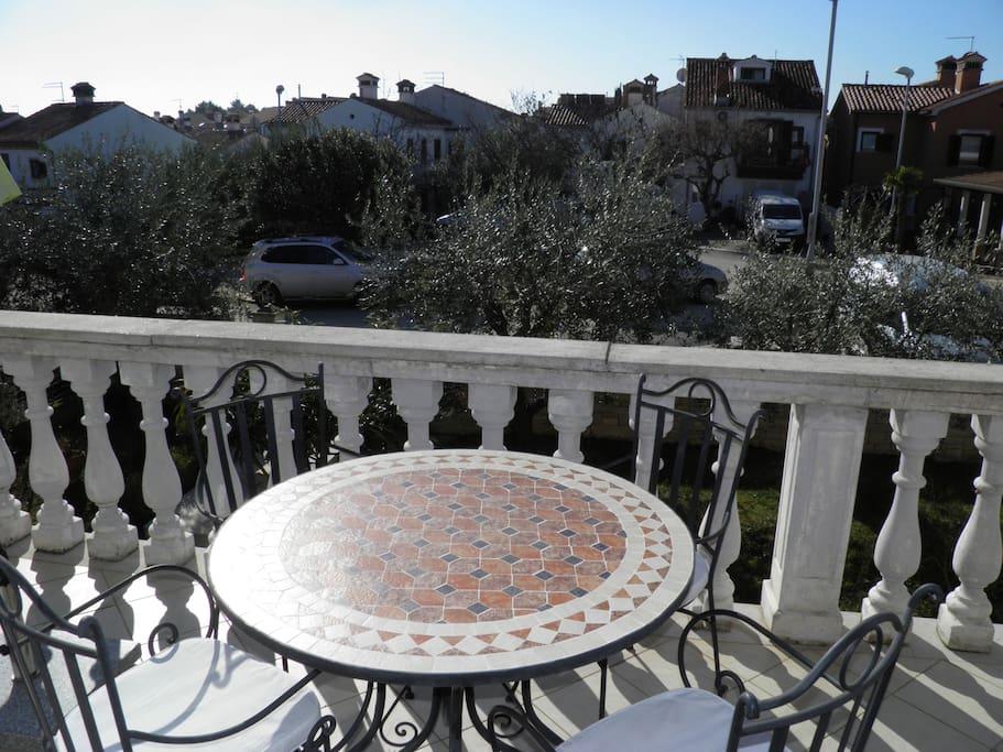 Nice sunny terrace with umbrella