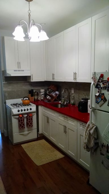Kitchen does not have a dishwasher, but does have full size fridge/freezer, oven/stove, microwave, and toaster.