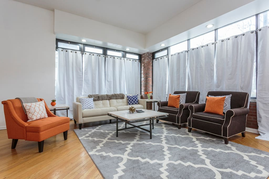 Our converted storefront condo has high ceilings and large windows, lending the living area an airy and open feel