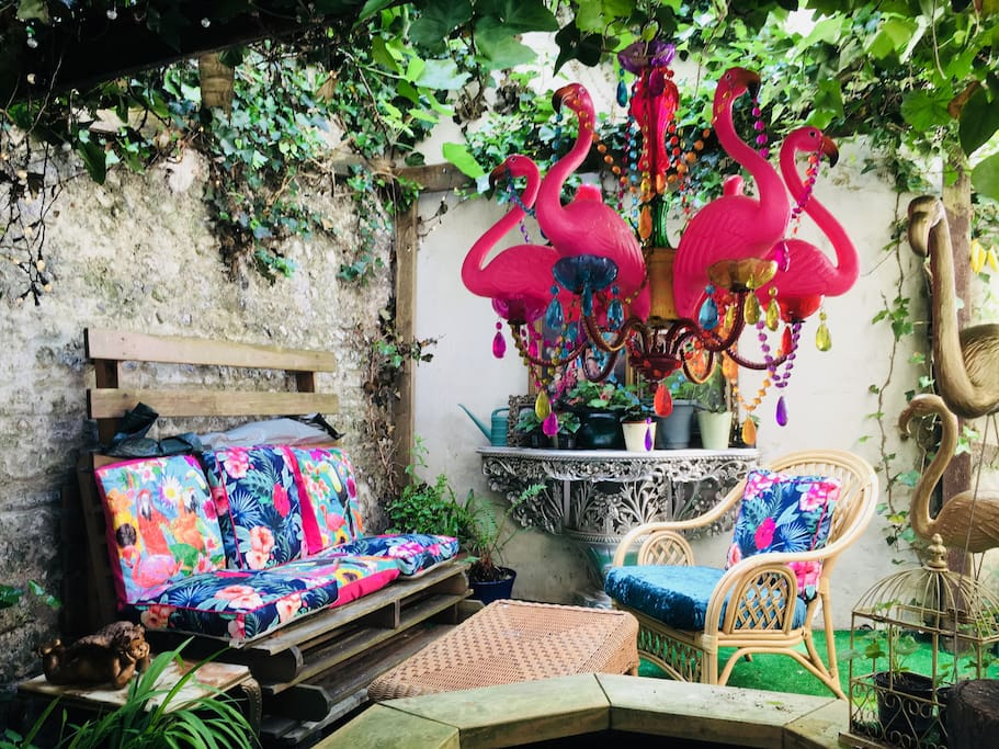 Private garden complete with flamingo chandelier and goldfish pond!