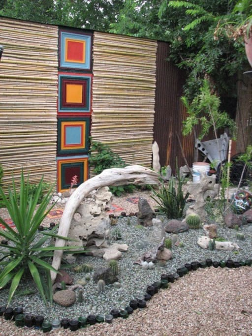 Back yard cactus garden and bamboo and metal panel feature.