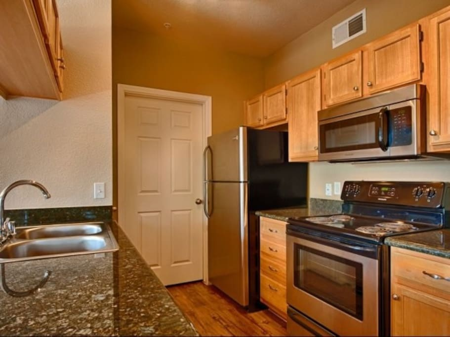 Spacious kitchen with interior laundry