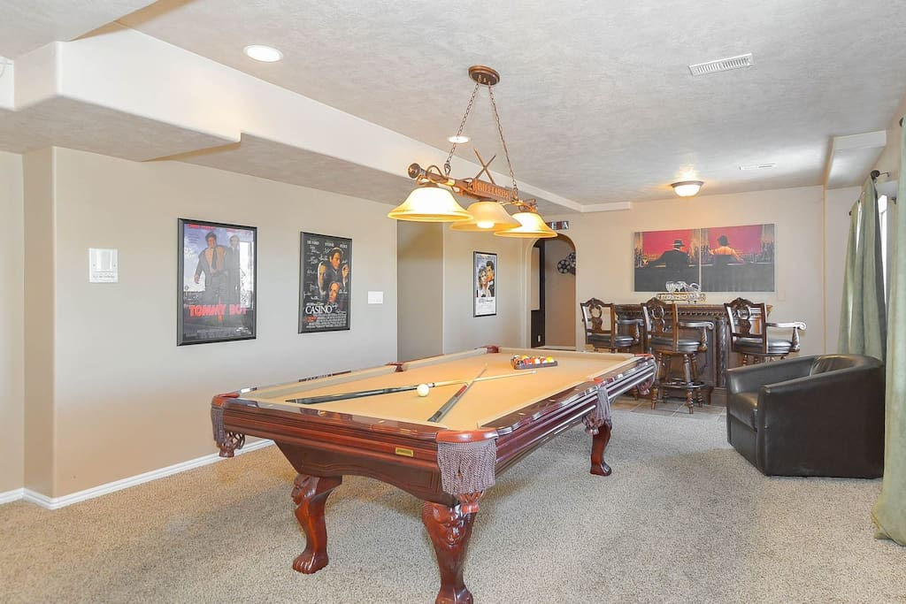 Billiard table in basement family room