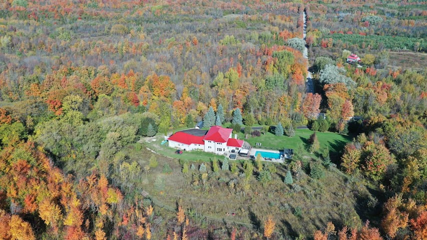 Surrounded by nature; 67 acres and over 3 km of private hiking trails.  Pretty River rd in the distance.