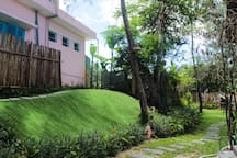 Charming and large green yard with a hill for chill out