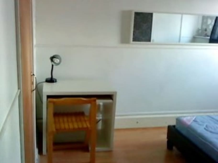 Bedroom: equipped with desk, chair, mirror and side lamp