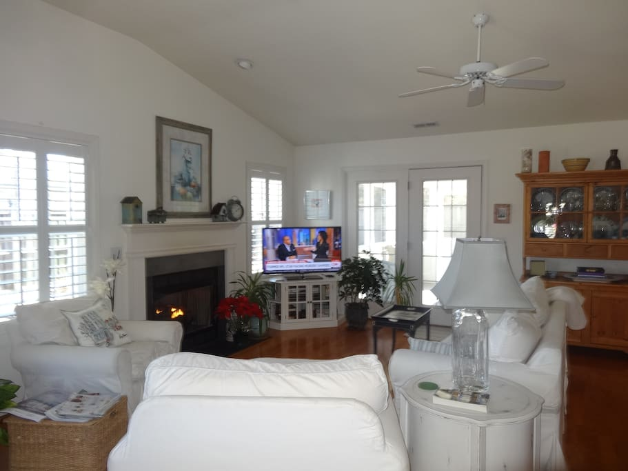 Living room, dining area with screen porch