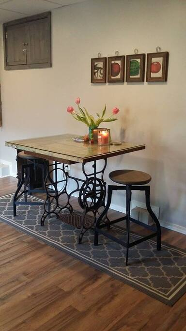 Dining table and adjustable stools.