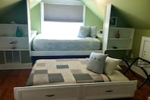 Queen bed with pull out trundle beneath.  Extra guest fee applies to each guest after the first two.
