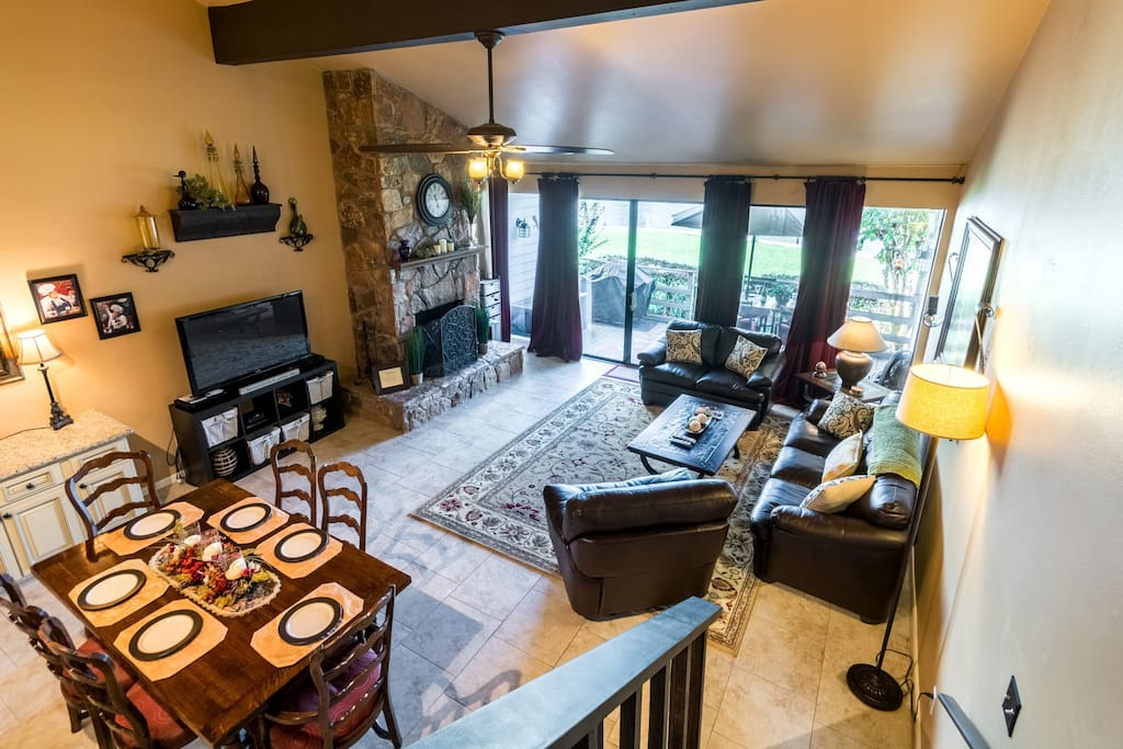Large living area with a wall of windows overlooking beautiful Lake Conroe.