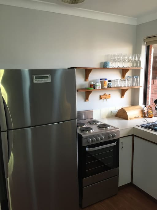 Full size fridge and fully equipped kitchen