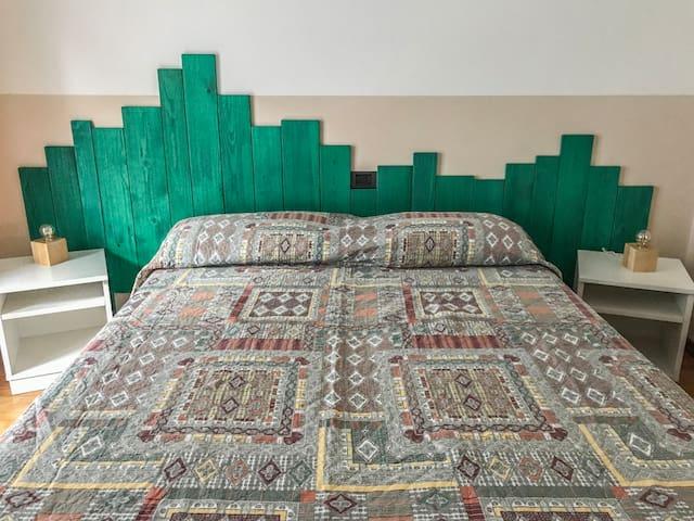 Camera Verde predisposta con 1 letto matrimoniale