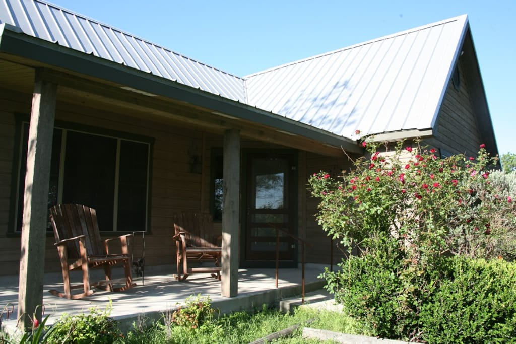 Front porch with rockers add charm to any stay.
