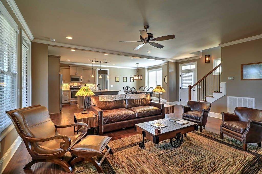 Lounge on the comfortable main-floor living room couches while watching your favorite movie or television series on the flat-screen TV.