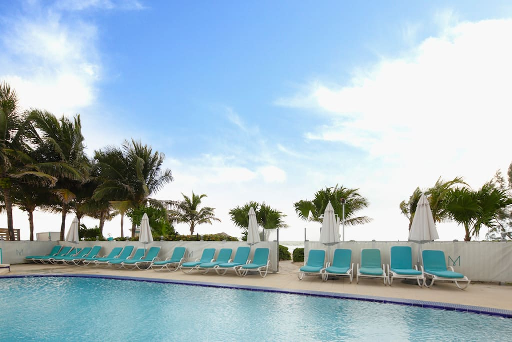 You can simply lounge by the pool and still enjoy the sea breeze