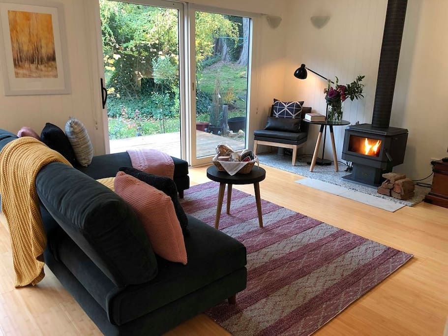 Living space with fire place for cosy mornings  and long afternoons