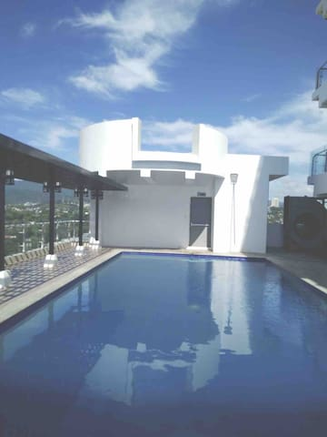 Rooftop pool and waterfall