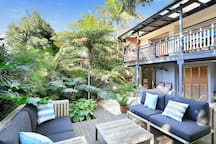 Leafy private garden with seating