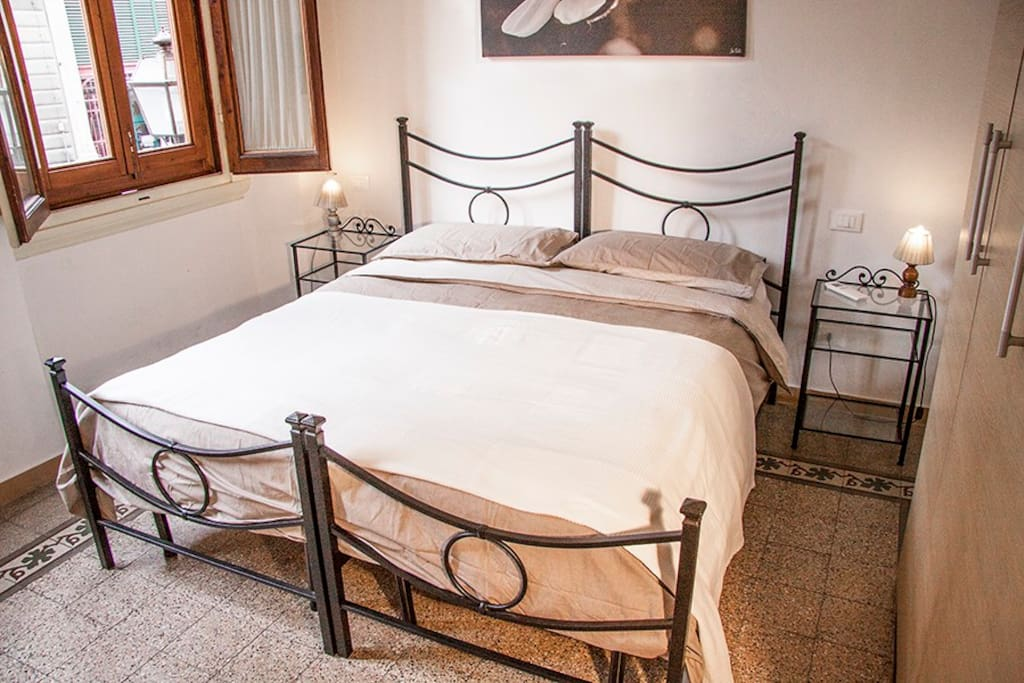Bedroom 1 - double bed. This room faces on the main square but double glazing keeps the noise out