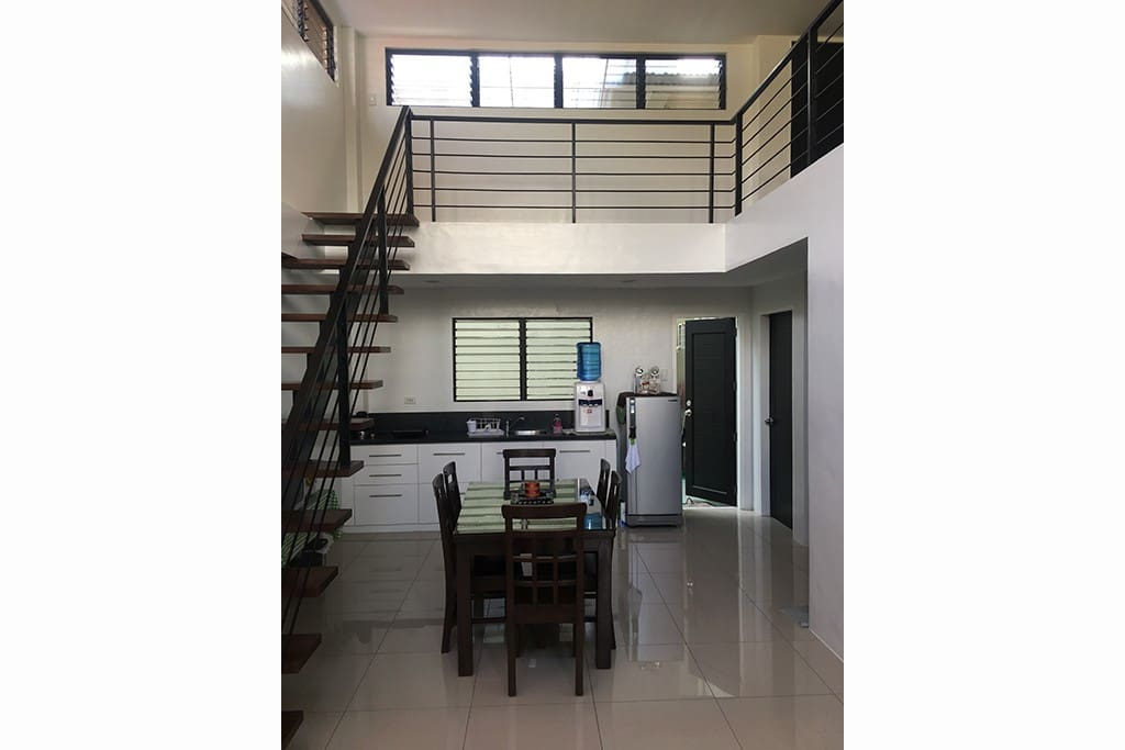 This is the stairs leading to the loft and the 6-seater dining table and small kitchen.