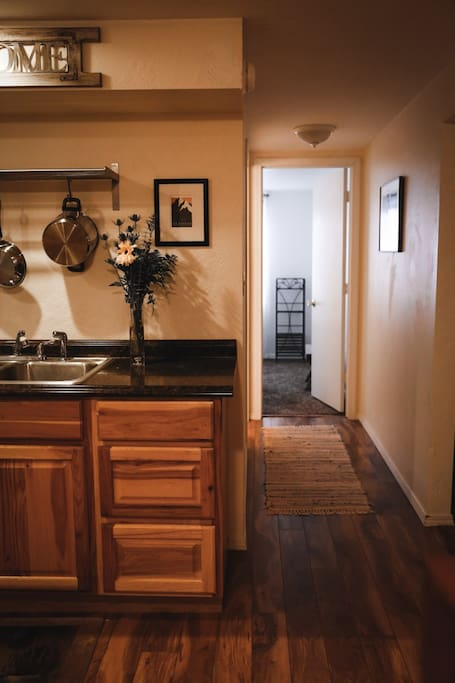 Hallway leading to bathroom and twin bedroom