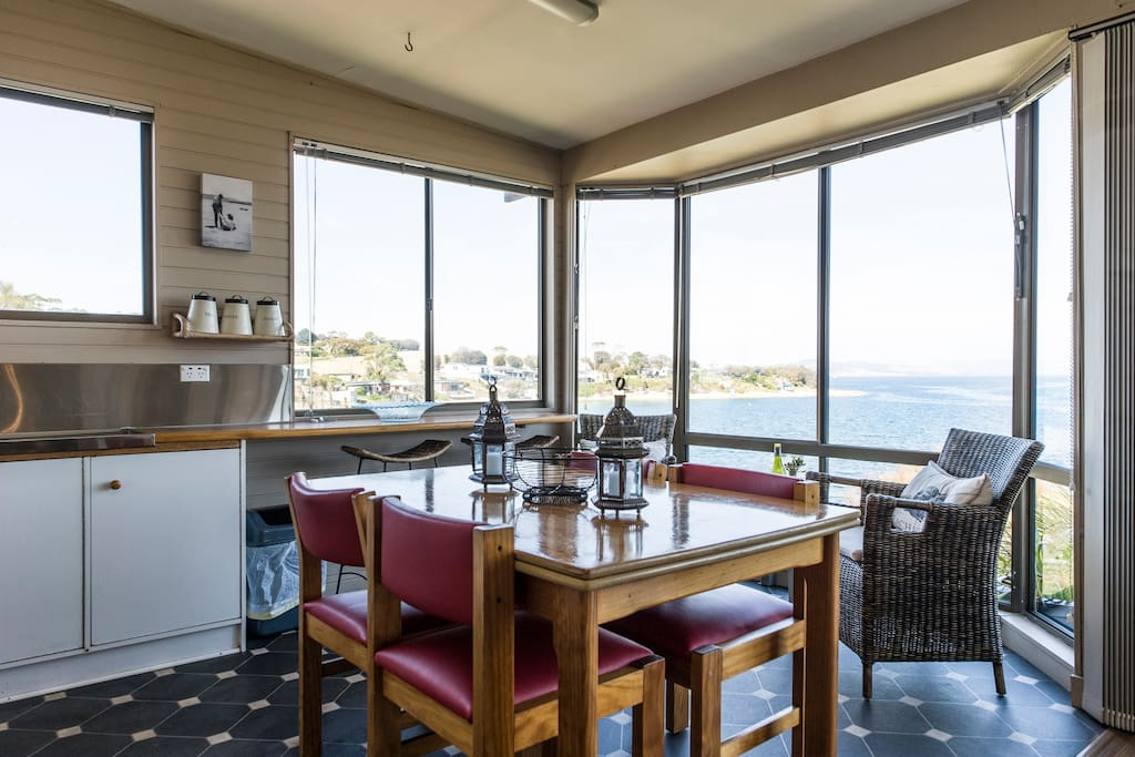 Imagine sitting by the picturesque kitchen windows with a cheese platter and wine enjoying those views. You may even spot a pod of dolphins, watch the cruise ships sail past or just watch the waves crashing on the beach