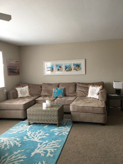 Relax the evening away after a day of sun and fun in this comfy living room.
