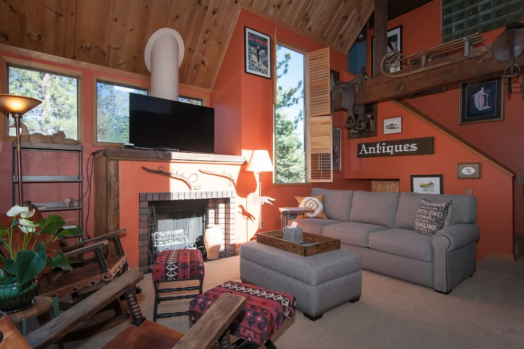 Relax in a light-filled living room with big picture windows and a tasteful mix of old and new decor! Large, flat screen TV with cable and a super comfy, king-size gel mattress within a brand-new sofa allows for comfortable seating and sleep.