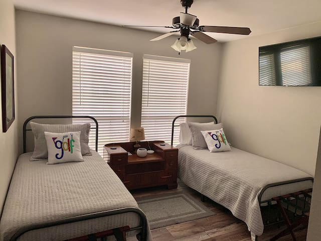 2-Twin beds with a golf theme. Mounted tv, phone chargers for both sides. This is a Jack-n-Jill set up. Shared bathroom in between bedrooms.
