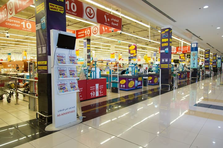 Just 2 minutes a walk  from the building  about 80m   From the property you will find carrefour supermarket  it's open  24  hours  Also you will  find. a huge  LuLu  market market beside the property