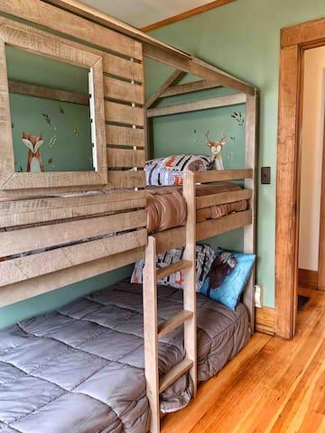 Twin bunk beds in The Wildlife Room.