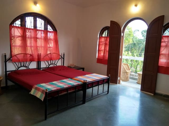 Private Room A3 with Balcony at Morjim Beach