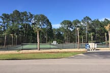 Tennis court right next to build.