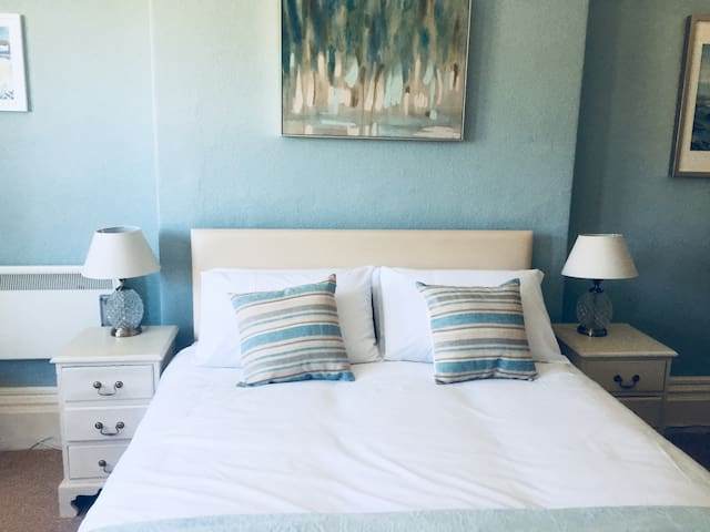 Bedroom 1  Kingsize bed.  Large wardrobe and dressing table with hairdryer.  Long length mirror on wardrobe door.  Beautiful large bay window to catch the morning sunshine.  TV with free view