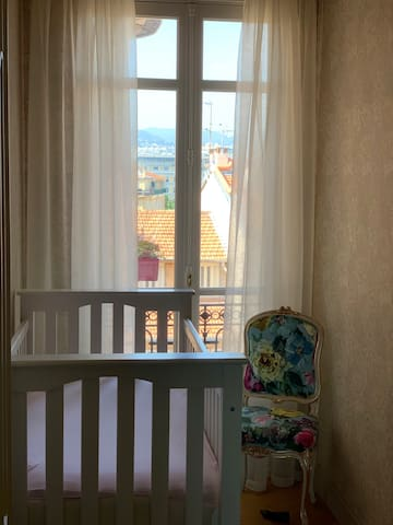 Boudoir with Crib and Chair.  Roller-shutter closes for nap time.