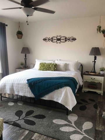 Master suite with soft hybrid pillow top mattress.