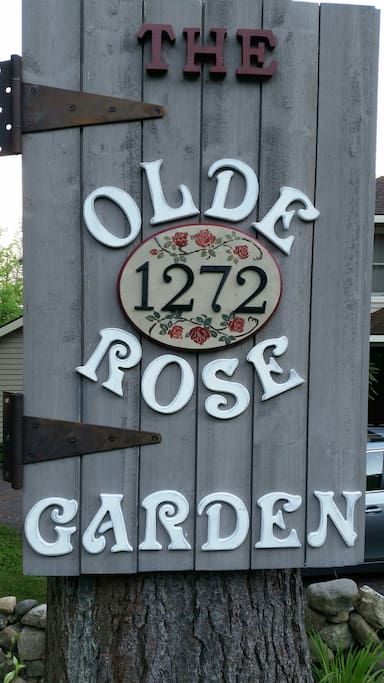 The history of this home is that it used to be a bar/restaurant which opened in 1938.  It was called the Rose Garden.  We made this sign to help folks find us. It is posted on a tree in the front of the house. Welcome....to the Olde Rose Garden!