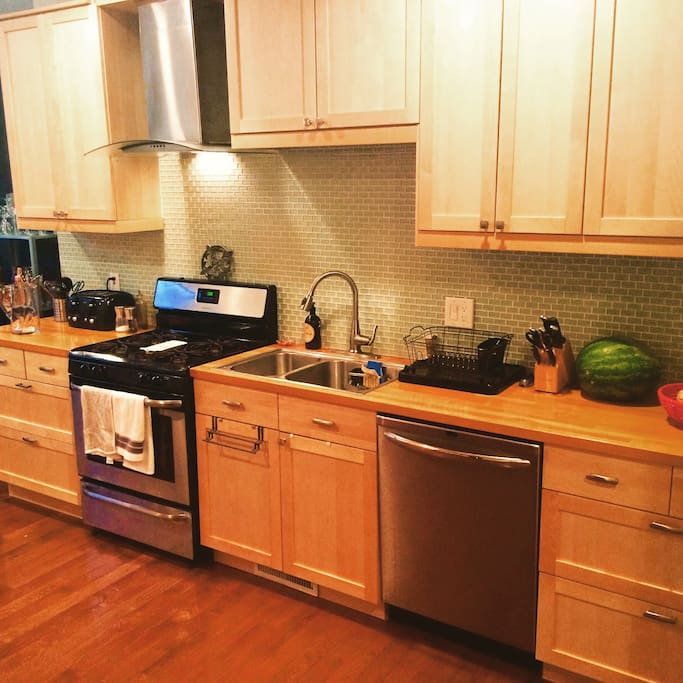 The kitchen is huge, with plenty of counter space and a new stainless steel gas range to prepare meals.