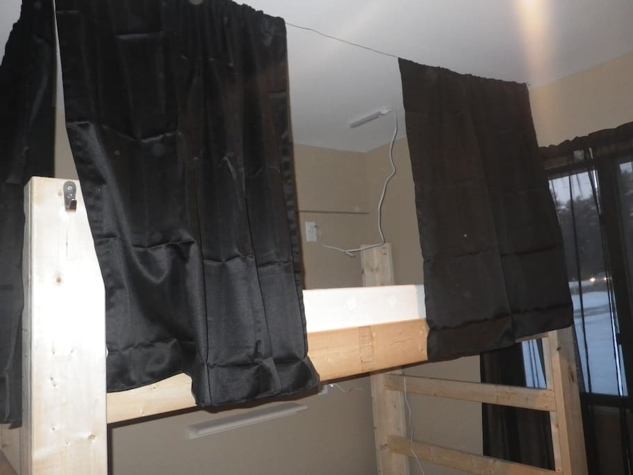 Bunk with black out curtains/ USB ports/ 110 outlets and led lights above bunk area for reading
