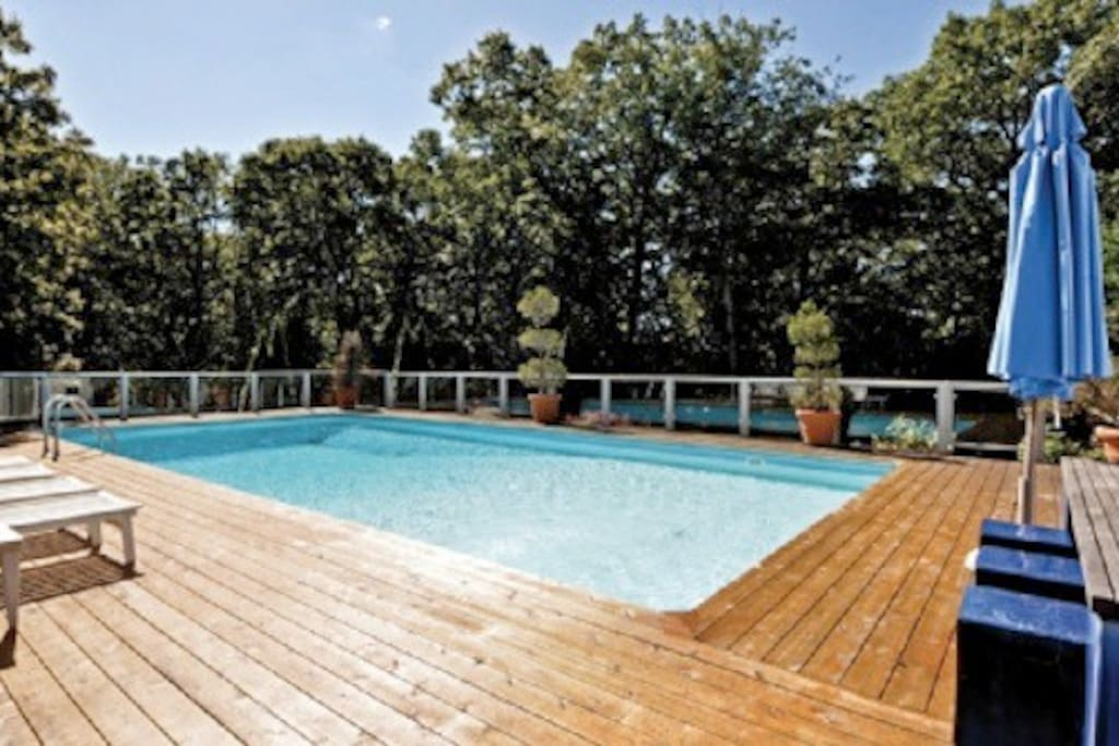 large swimming pool, outside dining for 8, sun loungers, sofa, umbrellas