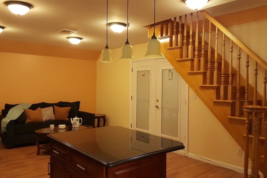"""Different angle; stairs go to a huge room with chandeliers. Island is part of kitchen. To see """"full kitchen view"""" please go to the last picture in this sequence."""