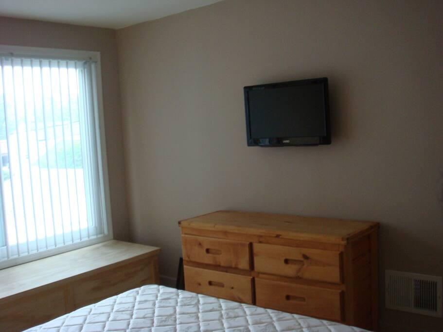 Room 1  Six drawer dresser & wall mounted TV.