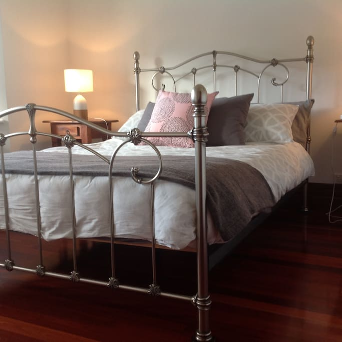 Comfortable Main Bedroom With Built in Robes and Bay Window Views