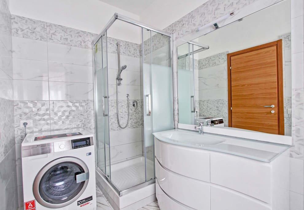 Bathroom with shower and washer/dryer