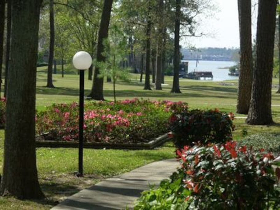 Lit, cement walking path winds throughout condoplex along golf course w/ a lovely view of the lake.