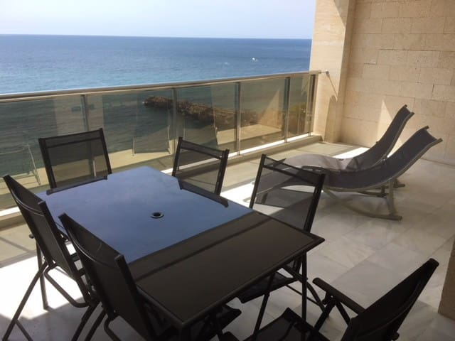 Terrace with dining and relaxing area and wonderful views.