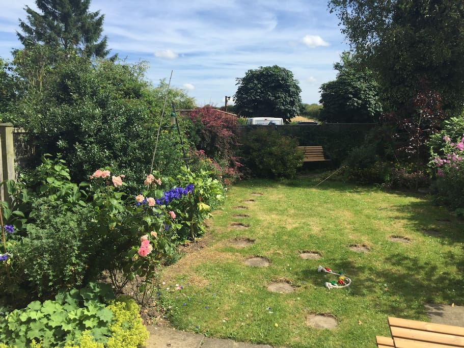 Back garden - entirely enclosed, overlooking fields and a haven for birds and wildlife.