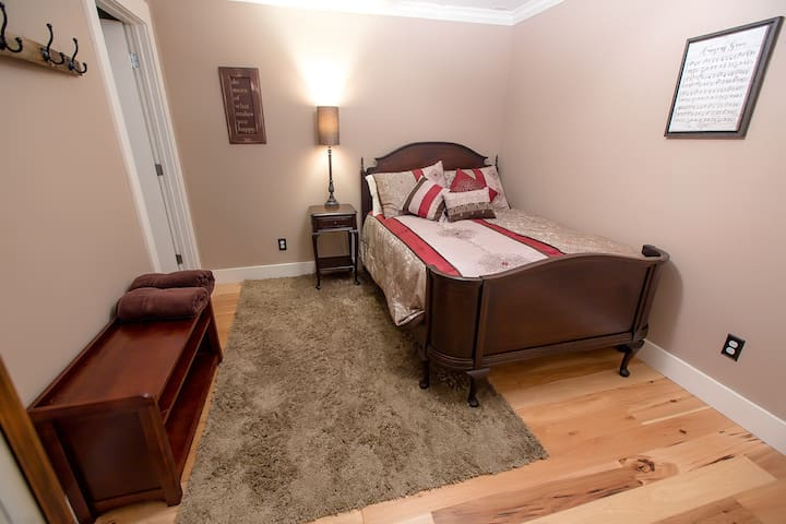 """Bedroom 3 features a full size restored antique bed and """"chifforobe"""" wardrobe (out of picture). Entrance to the laundry room is through the door at the back left."""