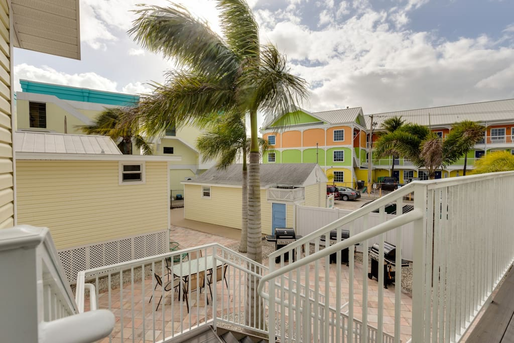 Private patio with view of Ft. Myers Beach and shared BBQ Grill area